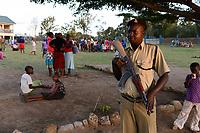 TANZANIA Mara, Tarime, village Masanga, region of the Kuria tribe who practise FGM Female Genital Mutilation, temporary rescue camp of the Diocese Musoma for girls which escaped from their villages to prevent FGM, , armed policeman secures the camp / TANSANIA Mara, Tarime, Dorf Masanga, in der Region lebt der Kuria Tribe, der FGM weibliche Genitalbeschneidung praktiziert, temporaerer Zufluchtsort fuer Maedchen, denen in ihrem Dorf Genitalverstuemmelung droht, in einer Schule der Dioezese Musoma, bewaffnete Polizisten schuetzen das Camp