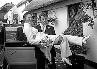 N Ireland international and Arsenal FC footballer,Terry Neill, with his bride, Sandra Lichfield, arriving at the reception in the Crawfordsburn Inn after their wedding in First Bangor Presbyterian Church, Bangor, Co Down, N Ireland, 4th November 1969. They met in March that year in Malta whilst Terry was touring with Arsenal and she was on a modelling assignment. 196911040256b<br /> <br /> Copyright Image from Victor Patterson, 54 Dorchester Park, Belfast, UK, BT9 6RJ<br /> <br /> Tel: +44 28 9066 1296<br /> Mob: +44 7802 353836<br /> Voicemail +44 20 8816 7153<br /> Skype: victorpattersonbelfast<br /> Email: victor@victorpatterson.com<br /> Email: victorpatterson@me.com (back-up)<br /> <br /> IMPORTANT: If you wish to use this image or any other of my images please go to www.victorpatterson.com and click on the Terms &amp; Conditions. Then contact me by email or phone with the reference number(s) of the image(s) concerned.