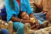 Maldhari boy in his father's hands..Michael Benanav - mbenanav@gmail.com