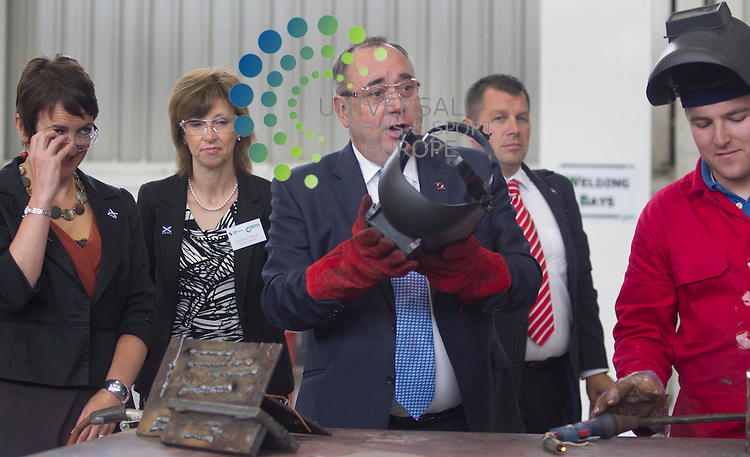 Alex salmond the first minister of Scotland during the official opening of Steel engineering's G2 facility Tresta in Renfrew with Ross Hughes (19) wotking on some steel..Picture: Maurice McDonald/Universal News And Sport (Europe). 23 August  2012. www.unpixs.com.
