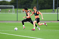 Yan Dhanda battles with George Byers of Swansea City during the Swansea City Training Session at The Fairwood Training Ground, Wales, UK. Tuesday 11th September 2018