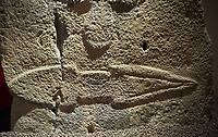 Close up of a Late European Neolithic prehistoric Menhir standing stone with carvings on its face side. At the bottom is a carving of a dagger running horizontally across the menhir.  From Barrili I site, Laconi. Menhir Museum, Museo della Statuaria Prehistorica in Sardegna, Museum of Prehoistoric Sardinian Statues, Palazzo Aymerich, Laconi, Sardinia, Italy