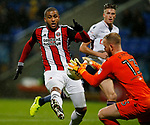 Leon Clarke of Sheffield Utd challenges Ben Alnwick of Bolton Wanderers during the Championship match at the Macron Stadium, Bolton. Picture date 12th September 2017. Picture credit should read: Simon Bellis/Sportimage