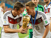 Miroslav Klose and Eric Durm of Germany lifts the World Cup trophy after winning the 2014 final