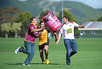 Horowhenua-Kapiti's Ryan Shelford passes a Pink Batt bale to King Country's Brian Mansfield (left) as Thames Valley's Blake Hill (centre) runs in support during the Pink Batts Heartland Championship 2013 season launch at Waikanae RFC, Waikanae, New Zealand on Tuesday, 13 August 2013. Photo: Dave Lintott / lintottphoto.co.nz