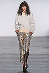 "Model Hadassa walks runway in a cotton sweatshirt in light grey and gold with lame jacquard trouser from the Vivienne Tam Fall Winter 2016 ""Cultural Dreamland The New Silk Road"" collection, presented at NYFW: The Shows Fall 2016, during New York Fashion Week Fall 2016."