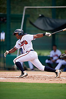 GCL Braves third baseman Braulio Vasquez (20) follows through on a swing during the second game of a doubleheader against the GCL Yankees West on July 30, 2018 at Champion Stadium in Kissimmee, Florida.  GCL Braves defeated GCL Yankees West 5-4.  (Mike Janes/Four Seam Images)