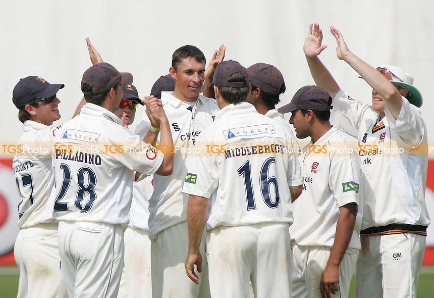 Andre Nel is congratulated by his Essex team mates after getting the wicket of R Dawson of Northants - Essex vs Northants - at Chelmsford, Essex - 09/06/07 - MANDATORY CREDIT: Rob Newell/TGSPHOTO