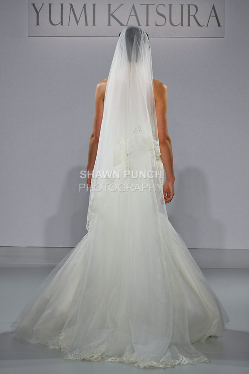 """Model walks runway in a Zurich with veil wedding dress from the Yumi Katsura Fall 2013 """"Painting The World With Beauty"""" bridal collection, during The Couture Show New York Bridal Fashion Week, October 14, 2012."""