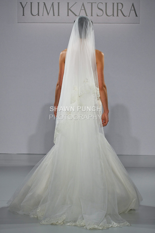 "Model walks runway in a Zurich with veil wedding dress from the Yumi Katsura Fall 2013 ""Painting The World With Beauty"" bridal collection, during The Couture Show New York Bridal Fashion Week, October 14, 2012."