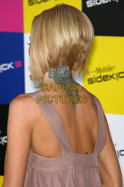 JENNA JAMESON.Attending the T-Mobile Sidekick iD Launch, .held at the T-Mobile Sidekick Lot,  Los Angeles, California, USA,13 April 2007..half length back behind tattoo on neck tattoos.CAP/ADM/ZL.©Zach Lipp/AdMedia/Capital Pictures.