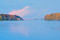 Trees reflected in the Saint John River at sunrise<br />
