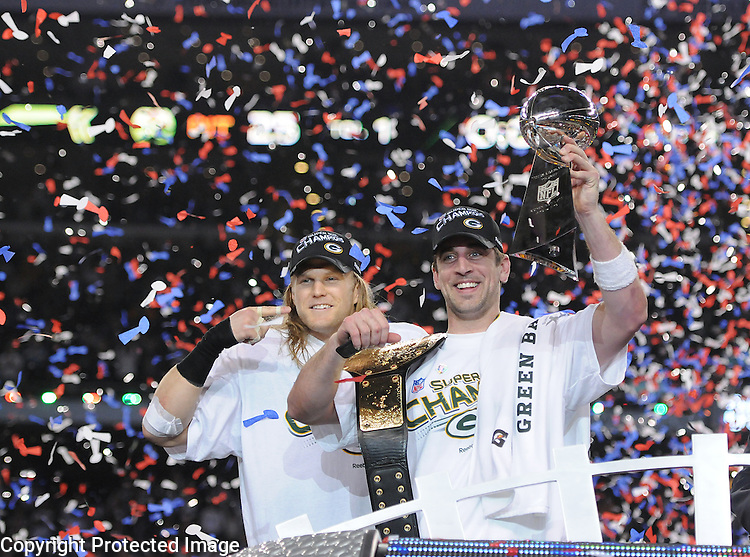 Green Bay Packers linebacker Clay Matthews, left, points to Super Bowl MVP Aaron Rodgers after giving him a championship belt after the win against the Pittsburgh Steelers during Super Bowl XLV at Cowboys Stadium in Arlington, Texas on Feb. 6, 2011.