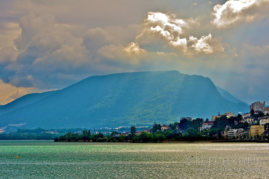 Sunbeams breaking through the clouds over Lake Neuchâtel