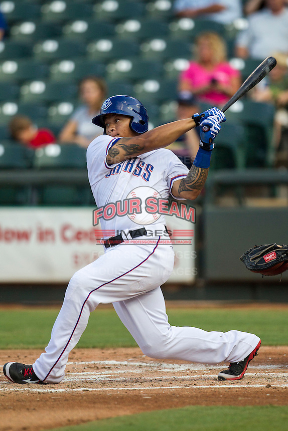 Round Rock Express outfielder Michael Choice (20) follows through on his swing during the second game of a Pacific Coast League doubleheader against the Memphis Redbirds on August 3, 2014 at the Dell Diamond in Round Rock, Texas. The Redbirds defeated the Express 7-6. (Andrew Woolley/Four Seam Images)