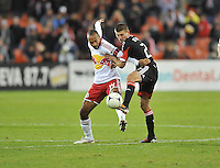 D.C. United midfielder Perry Kitchen (23) goes against New York Red Bulls forward Thierry Henry (14)  The New York Red Bulls tied D.C. United 1-1 in the first leg of the Eastern Conference semifinals at RFK Stadium, Saturday November 3, 2012.