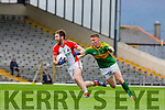 Kevin Gorman  Kilcummin goes past Denis Daly South Kerry  during their County Championship quarter final in Fitzgerald Stadium on Saturday