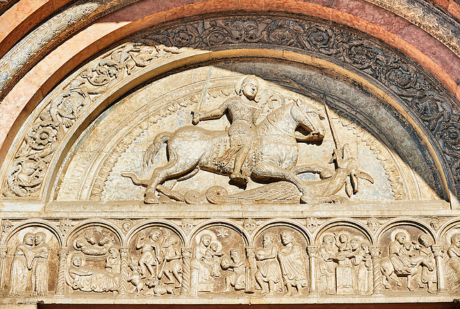 Main portal lunette sculpture of St George, patron Saint of Farrara,  killing the Dragon, the work of the sculptor Nicholaus,  the 12th century Romanesque Ferrara Duomo, Italy