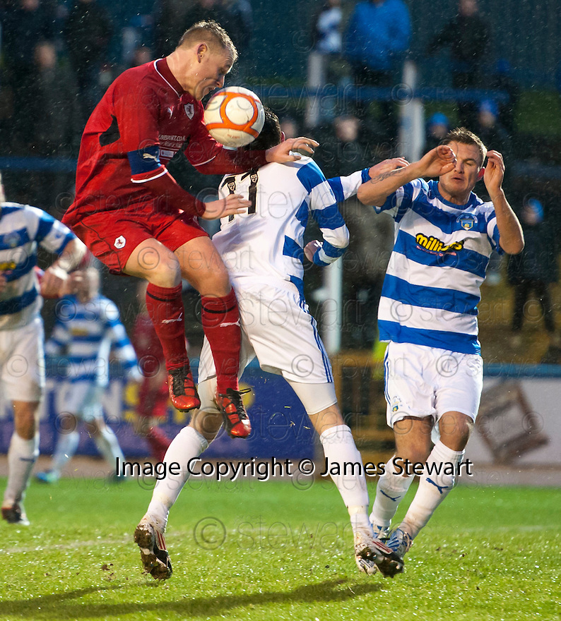 Raith's Allan Walker header is blocked by Morton's David O'Brien.
