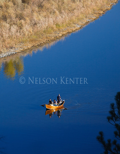 Fishermen in a drift boat on the Clark Fork River outside of Missoula, Montana