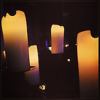 Several candles help illuminate the ball room at Cescaphe on February 17, 2013.