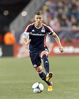 New England Revolution defender Chris Tierney (8) passes the ball. In a Major League Soccer (MLS) match, the New England Revolution (blue/red) defeated Philadelphia Union (blue/white), 2-0, at Gillette Stadium on April 27, 2013.