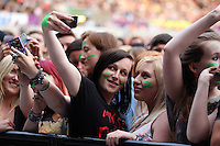 Pictured: Revellers during the Kings of Leon performance. Wednesday 02 July 2014<br /> Re: Kings of Leon at the Liberty Stadium, Swansea, south Wales.