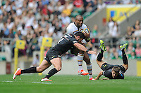 Sailosi Tagicakibau of Wasps is tackled by Brad Barritt of Saracens as Richard Wigglesworth of Saracens looks on from the ground during the Premiership Rugby Round 1 match between Saracens and Wasps at Twickenham Stadium on Saturday 6th September 2014 (Photo by Rob Munro)