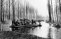 BNPS.co.uk (01202 558833)<br /> NARA/BNPS<br /> <br /> US combat engineers cross a swollen northern Rhineland stream. <br /> <br /> Remarkable rarely seen photos of heroic Allied soldiers fighting their way across Europe before crossing the River Rhine 75 years ago feature in a new book.<br /> <br /> They are published in Images of War, Montgomery's Rhine Crossing, which tells the story of the legendary offensive, nicknamed Operation Plunder, in March 1945.<br /> <br /> On the night of March 23, Field Marshal Bernard Montgomery's 21st Army Group launched a massive artillery, amphibious and airborne assault to breach the historic defensive water barrier protecting northern Germany.<br /> <br /> At the same time, the Americans, with the support of the British 6th Airborne Division, set in motion Operation Varsity - involving 16,000 paratroopers - on the east bank of the Rhine. They were dropped here to seize bridges to prevent German reinforcements from contesting the bridgeheads.<br /> <br /> Fierce fighting ensued, with much bloodshed on both sides as the Allies met determined resistance from machine gun nests. But the daring operation proved successful, helping to considerably shorten the war - the Nazis surrendered just six weeks later.