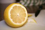 Fresh yellow lemon on cutting board with knife