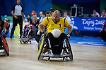 Australia's George Hucks works hard for a goal in the semi final of the Wheelchair Rugby at the USTB Gymnasium at the Paralympic games, Beijing, China 15th September 2008