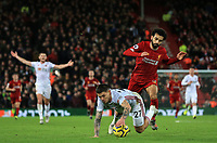 2nd January 2020; Anfield, Liverpool, Merseyside, England; English Premier League Football, Liverpool versus Sheffield United; Mohammed Salah of Liverpool tangles with Muhamed Besic of Sheffield United as they compete for the ball on the edge of the penalty area - Strictly Editorial Use Only. No use with unauthorized audio, video, data, fixture lists, club/league logos or 'live' services. Online in-match use limited to 120 images, no video emulation. No use in betting, games or single club/league/player publications