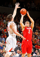 Maryland guard Logan Aronhalt (2) shoots a three point basket next to Virginia guard Joe Harris (12) during the game Sunday in Charlottesville, VA.  Photo/Andrew Shurtleff