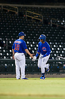 AZL Cubs left fielder Nelson Velazquez (20) is congratulated after hitting a home run during a game against the AZL Brewers on August 6, 2017 at Sloan Park in Mesa, Arizona. AZL Cubs defeated the AZL Brewers 8-7. (Zachary Lucy/Four Seam Images)