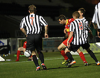 Scott Gray surrounded by (l to r) Graeme McGregor, Jon Robertson and Mark Williams in the St Mirren v Dunfermline Athletic Clydesdale Bank Scottish Premier League U20 match played at St Mirren Park, Paisley on 2.10.12.