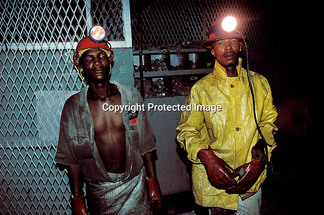 "IDMININ14039.Industry. Mining. Wesselton mine, Kimberley. Diamond mine workers in the "" Lunch Room"". Overalls, gloves, light, safety hat..©Per-Anders Pettersson/iAfrika Photos"