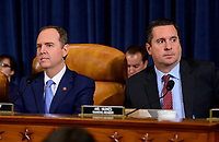 """United States Representative Adam Schiff (Democrat of California), Chairman, US House Permanent Select Committee on Intelligence, left, and US Representative Devin Nunes (Republican of California), Ranking Member, US House Permanent Select Committee on Intelligence, right, await the arrival of Marie """"Masha"""" Yovanovitch, former US Ambassador to Kyiv, Ukraine, on behalf of the US Department of State, who will testify during the US House Permanent Select Committee on Intelligence public hearing as they investigate the impeachment of US President Donald J. Trump on Capitol Hill in Washington, DC on Friday, November 15, 2019. Credit: Ron Sachs / CNP/AdMedia"""