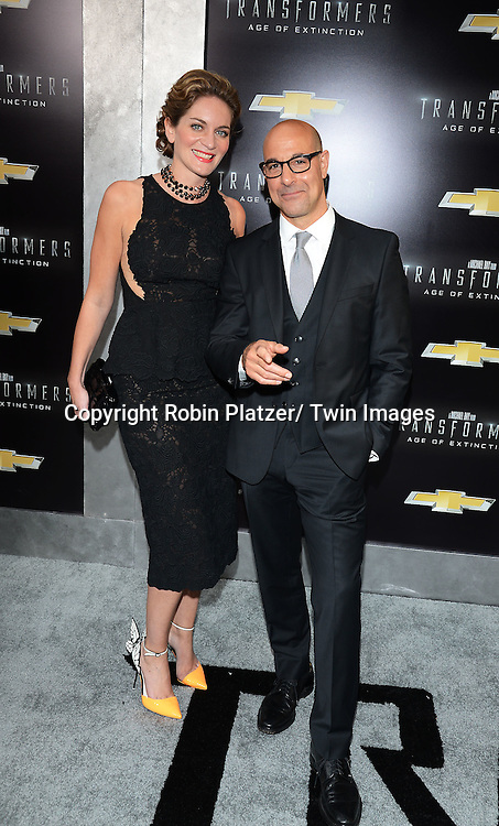 "Felicity Blunt and Stanley Tucci attends the US Premiere of ""Transformers: Age of Extinction"" on June 25, 2014 at The Ziegfeld Theatre in New York City, New York, USA."