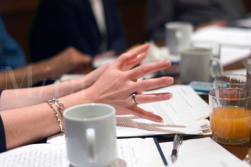 A woman's hands during a business meeting.
