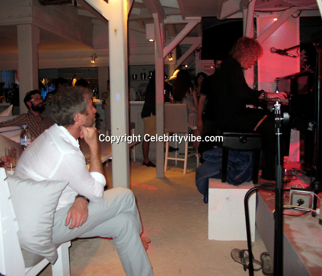 **EXCLUSIVE**.Roman Abramovich and Roman Abramovich and David Bryan, Keyboard Player and Founding Member of Bon Jovi..Roman Abramovich Party..La Plage Restaurant..St Barth, Caribbean..Monday, December 28, 2009..Photo By Celebrityvibe.com.To license this image please call (212) 410 5354; or Email: celebrityvibe@gmail.com ; .website: www.celebrityvibe.com.