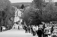 peloton cruising through the Ardennes with a jaywalker ahead<br /> <br /> 103rd Liège-Bastogne-Liège 2017 (1.UWT)<br /> One Day Race: Liège › Ans (258km)