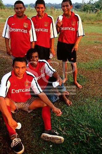 Altamira, Brazil. Football; members of the Campealta Co-operative football team wearing Nike Arsenal football shirts.