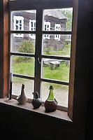 Botttles onm window at Fort Ross. California