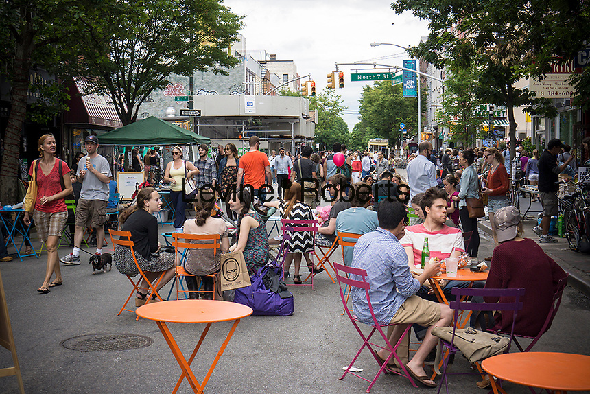 "Bedford Avenue is closed for ""Williamsburg Walks: Rethink Your Public Space"" in the trendy hipster Williamsburg neighborhood of Brooklyn in New York on Saturday, June 8, 2013. The Dept. of Transportation closes several blocks in various neighborhoods for street activity where tables and chairs (and grass lawns) are set out and merchants vend their wares on the streets. © Richard B. Levine)"