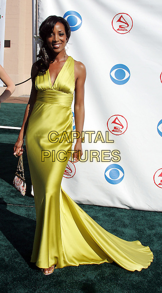 SHAUN ROBINSON.The 5th Annual Latin Grammy Awards held at The Shrine Auditoreum in Los Angeles, California.September 1st, 2004.full length, silk, satin dress, gown, lime green.www.capitalpictures.com.sales@capitalpictures.com.Copyright by Debbie VanStory