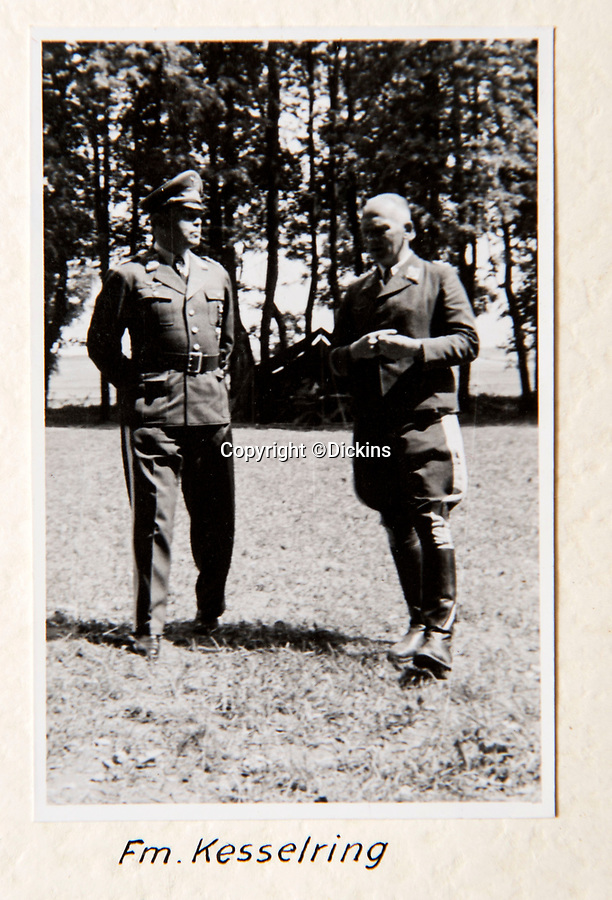 BNPS.co.uk (01202 558833)<br /> Pic: Dickins/BNPS<br /> <br /> Operation Barbarossa - Richthofen(r) with General Kesselring<br /> <br /> The unseen personal photo album of Field Marshal Wolfram von Richthofen, cousin to the legendary Red Baron, which gives an unprecedented insight into his military career in the Third Reich, has been rediscovered.<br /> <br /> Wolfram served in the Red Baron's squadron in the WW1, went on to design the 'Jericho trumpet' of the infamous Stuka Bomber between the wars, before leading the Condor Legion in the Spanish Civil War.<br /> <br /> After the outbreak of WW2 the fascinating album shows Richthofen's lead roll in Operation Barbarossa - the Nazi's suprise invasion of Communist Russia and their race to conquer the vast country before the onset of the notorious Russian winter.<br /> <br /> The two albums were taken from Berlin by a British soldier at the end of the Second World War who kept it for 60 years before it was passed into the hands of a private collector.<br /> <br /> Dickins auctions are selling the historic albums with a £20,000 estimate on 31st March.