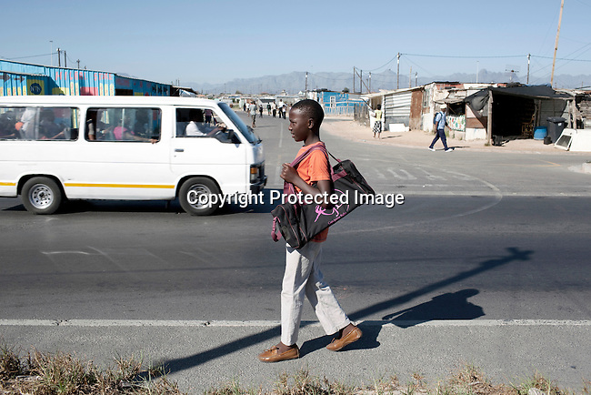 CAPE TOWN, SOUTH AFRICA - MARCH 15: Sikhumbuzo Hlahleni, age 15,  walks to take a taxi to train Cape Town City Ballet's youth company on March 15, 2010 in Cape Town, South Africa. He trains in Cape Town every Saturday. He also trains a few days week at home in Khayelitsha, a poor township outside Cape Town. He has to change taxi three times to get to the school.  (Photo by Per-Anders Pettersson).