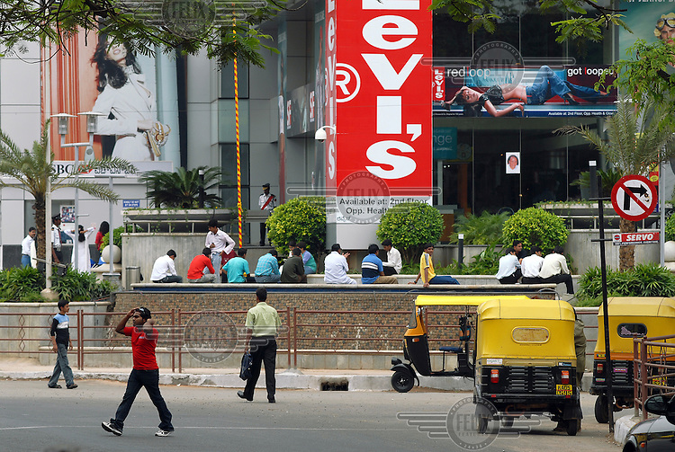 A huge billboard, advertising the Levi's fashion brand, stands outside a Bangalore shopping mall.