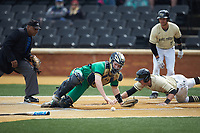 Cole McNamee (40) of the Wake Forest Demon Deacons slaps his hand on home plate as Notre Dame Fighting Irish catcher Jack Alexander (8) can't handle the throw at David F. Couch Ballpark on March 10, 2019 in  Winston-Salem, North Carolina. The Demon Deacons defeated the Fighting Irish 7-4 in game one of a double-header.  (Brian Westerholt/Four Seam Images)