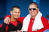 Batavia Muckdogs catcher Juan Castillo #35 and trainer Mike Petrarca before the second game of a doubleheader against the Mahoning Valley Scrappers at Dwyer Stadium on August 22, 2011 in Batavia, New York.  Mahoning Valley defeated Batavia 11-3.  (Mike Janes/Four Seam Images)